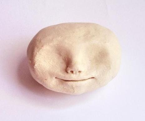 Как слепить голову куколки из полимерной глины (3)