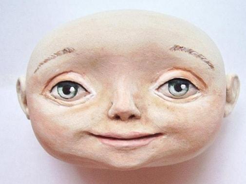 Как слепить голову куколки из полимерной глины (5)